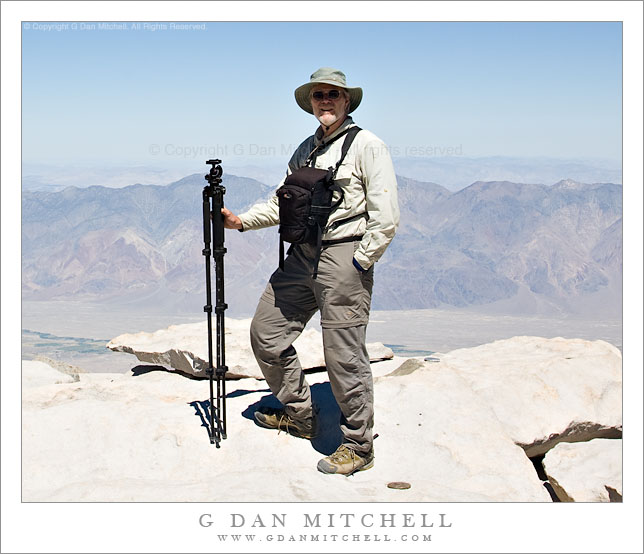 G Dan Mitchell with (some) trail photo equipment on the summit of Mt. Whitney.