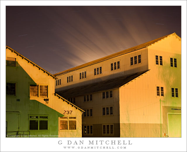 Yellow Buildings, Shadows, Moving Clouds - Night photograph of two large yellow buildings, shadows, and streaks for clouds moving across the sky above the Mare Island Naval Ship Yard, California.