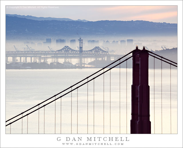 Golden Gate Bridge and San Francisco Bay, Morning Haze - Winter morning haze partially obstructs the view across San Francisco Bay, including the Golden Gate Bridge, Treasure Island, the San Francisco-Oakland Bay Bridge, and the city of Oakland.