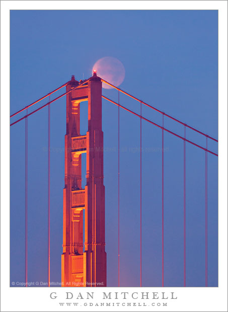 Golden Gate Bridge and Lunar Eclipse - The moon, in full lunar eclipse, passes behind the south tower of the Golden Gate Bridge.