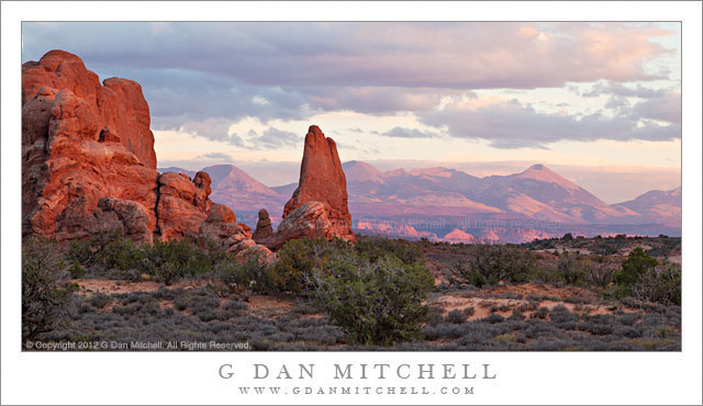 La Sal Mountains, Evening - Sunset light on sandstone towers of Arches National Park and on the distant La Sal Mountains, Utah